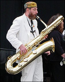 Saxophone player, Jim Barret, suffers neck and back pain from playing and carrying his instrument