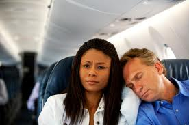 Sleeping on plane on another shoulder