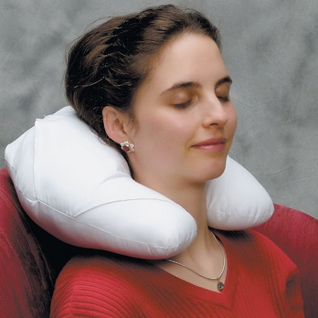 Headache ice pillo being used in a seated position