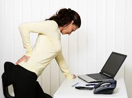 Woman back pain on computer