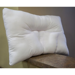 Arc4life traction neck pillow sitting on ledge