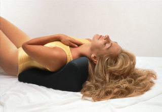 Patient lying on Soothe A Ciser for Gentle Neck Stretch